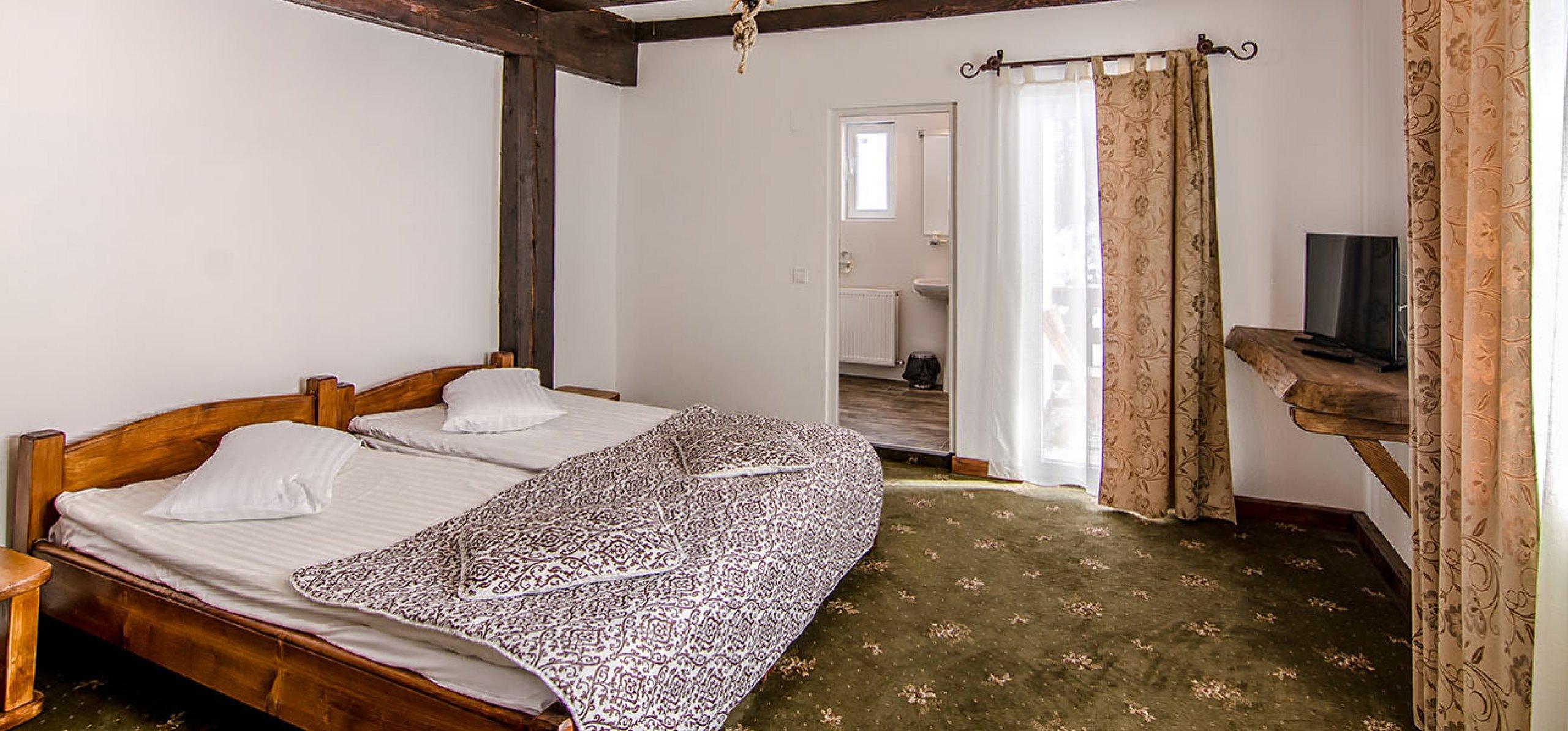 camera-dubla-twin-spatioasa-hotel-gradistea-hoteluri-moeciu